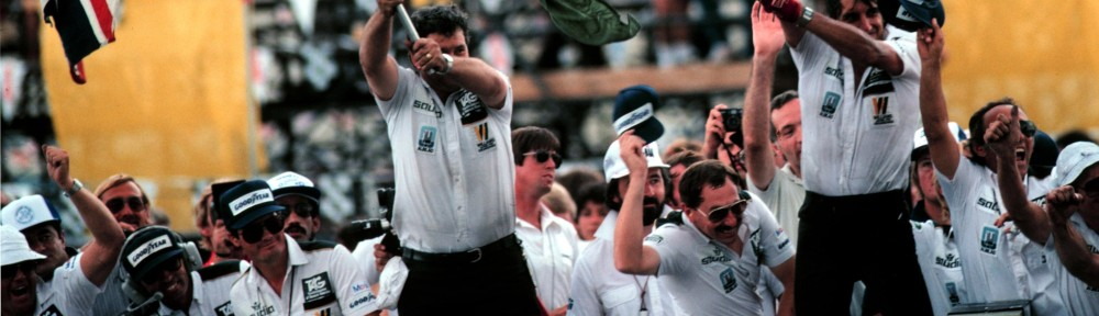 The Williams F1 Team celebrate winning the 1982 Formula One World Championship on the pit wall in Las Vagas