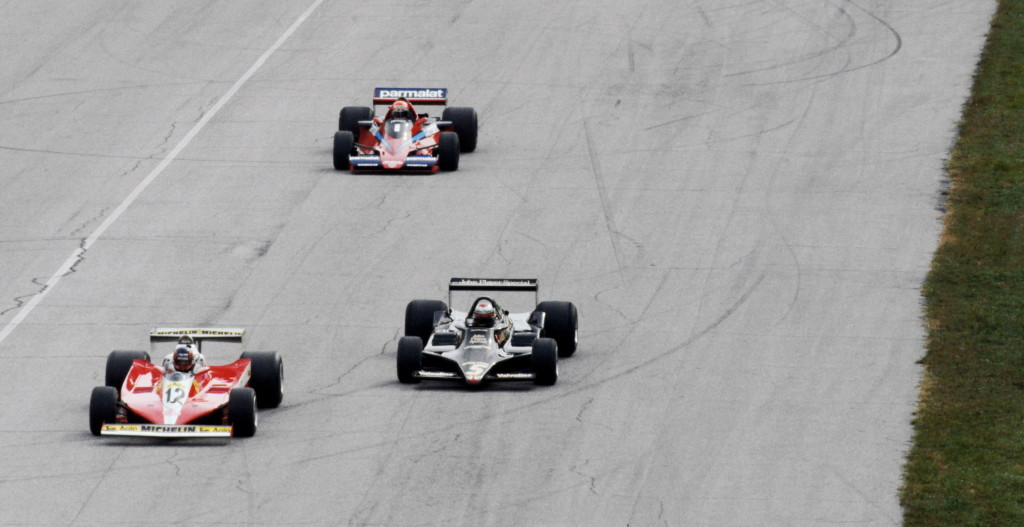 (L to R): Gilles Villeneuve (CDN) Ferrari 312T3 leads pole sitter Mario Andretti (USA) Lotus 79 away on the warm up lap of the opening start of the race. Both would jump the restart and were awarded one minute penalties, relegating them to seventh and sixth places respectively. Italian Grand Prix, Rd 14, Monza, Italy, 10 September 1978.