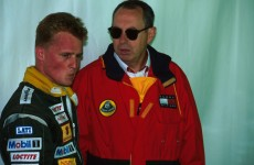 Lotus team principal Peter Collins (GBR) talks with Johnny Herbert (GBR) after his retirement from the race Italian GP, Monza, 11 September 1994